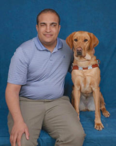 Christopher O'Meally with his Guiding Eyes for the Blind trained guide dog, Eden.