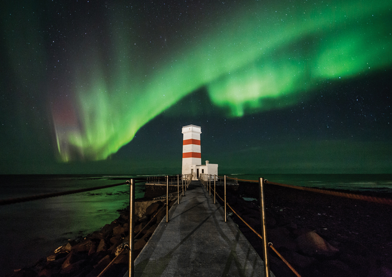 The lights over the lighthouse at Gardskagi. Photograph by Gardar Olafsson