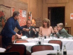 "The movie ""A Christmas Story"", directed by Bob Clark, based on the novel, 'In God We Trust, All Others Pay Cash', by Jean Shepherd. Seen here from left, John Wong as Chop Suey Palace Owner, Darren McGavin as Mr. Parker, Melinda Dillon as Mrs. Parker, Ian Petrella as Randy Parker and Peter Billingsley as Ralphie Parker. Initial theatrical release November 18, 1983. Screen capture. © 1983 Metro-Goldwyn-Mayer / United Artists Entertainment. Credit: © 1983 MGM/UA / Flickr / Courtesy Pikturz. Image intended only for use to help promote the film, in an editorial, non-commercial context."