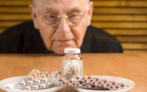 Senior man and his pills Image