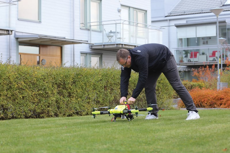 A member of the Karolinska study team testing the AED drone