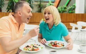 Joyful married couple eating healthy food Image