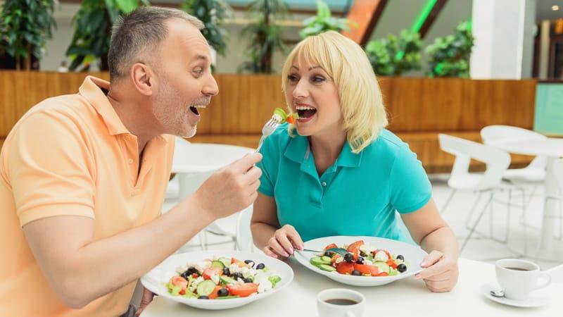 Joyful married couple eating healthy food Image