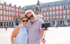 Happy retired senior tourist Couple Standing Taking Selfie in a European city Image