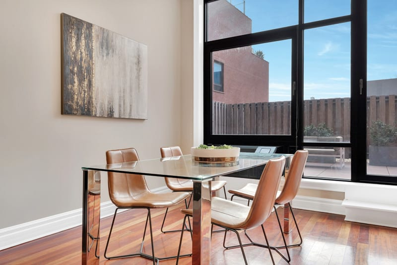 A glass table helps make a small dining area feel light and airy