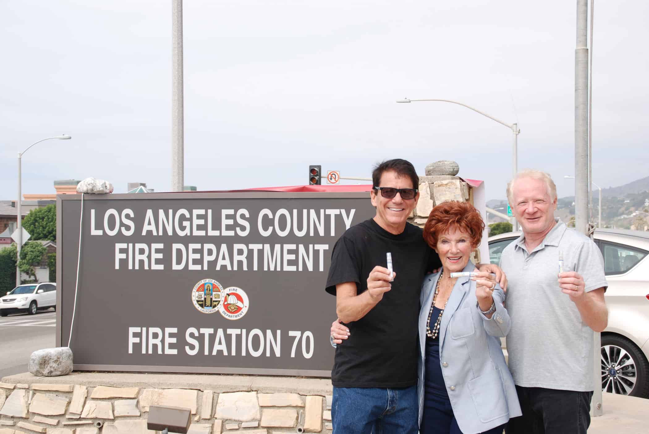 Anson Williams, Marion Ross and Don Most from Happy Days in recent photo holding containers of Alert Drops