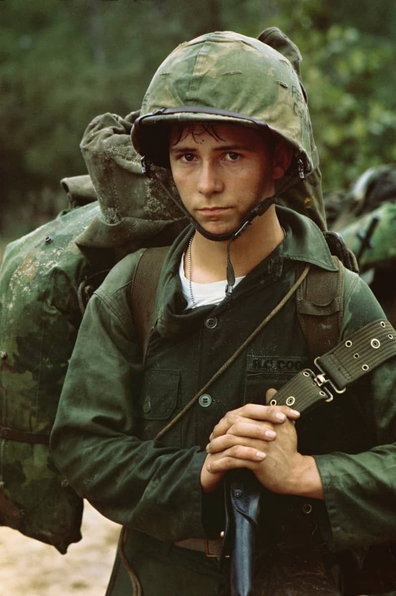 A young Marine private waits on the beach during the Marine landing at Da Nang, Vietnam