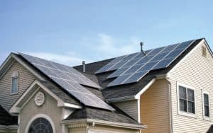 Renewable Green Energy Solar Panels on House Roof Image