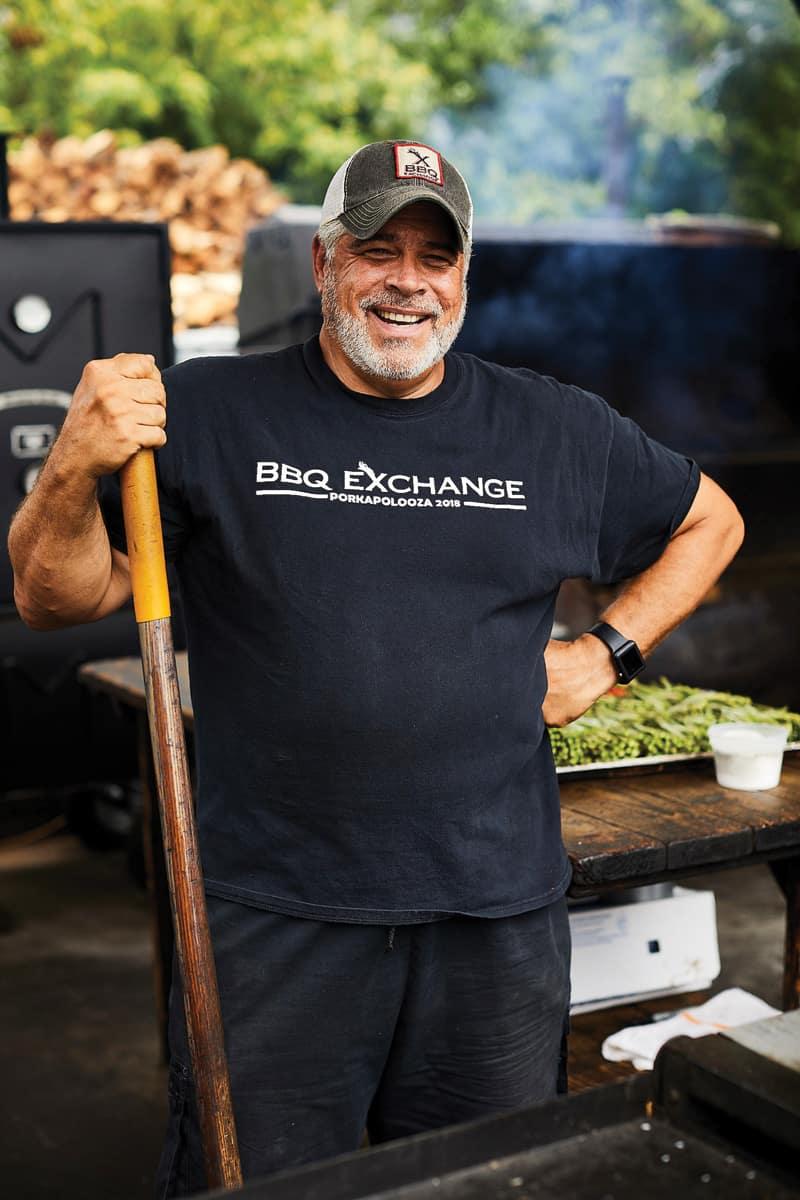 Craig Hartman of Gordonsville's BBQ Exchange doing what he does best