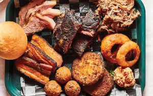 Barbecue tray from Gordonsville's BBQ Exchange with onion rings, hush puppies, pork Image