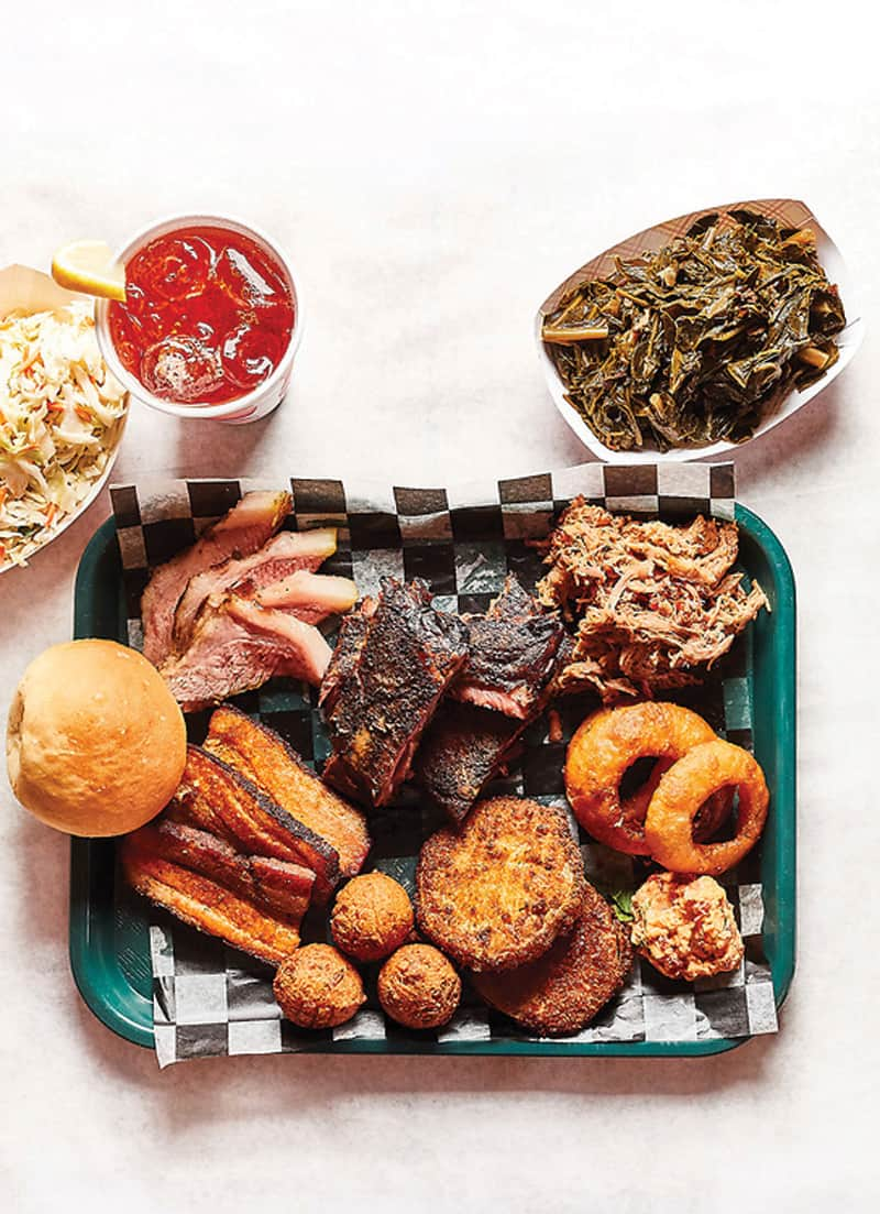 Barbecue tray from Gordonsville's BBQ Exchange with onion rings, hush puppies, pork