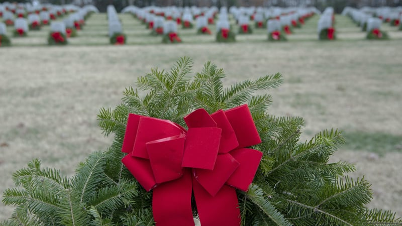 Wreaths Across America decorating veteran graves in holiday wreaths Image