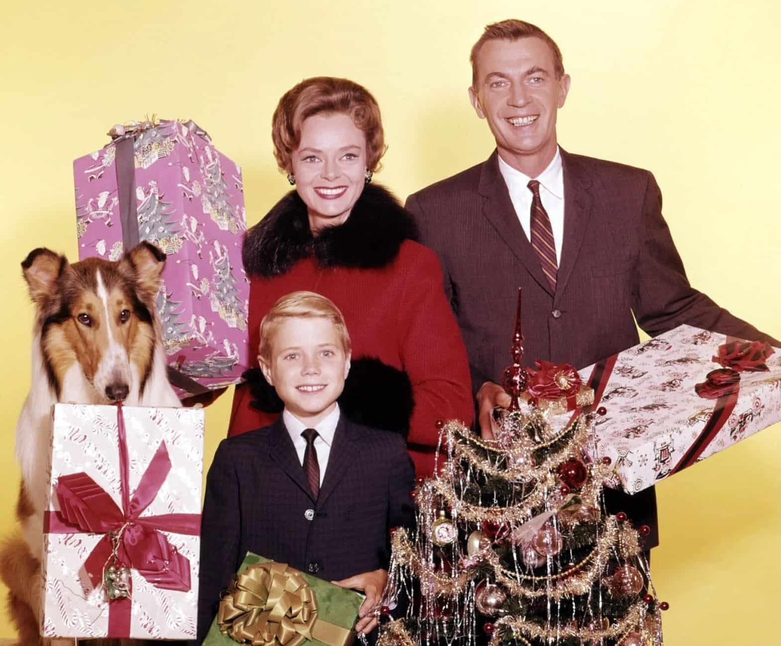 Jon Provost, June Lockhart, Hugh Reilly, and Lassie pose for a Christmas photo