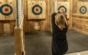 Woman at axe throwing bar in Richmond Image