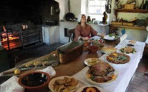 A reenactor from Colonial Williamsburg in the kitchen Image