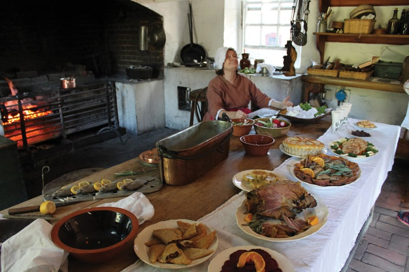 A reenactor from Colonial Williamsburg in the kitchen