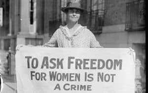 Suffragette holding a sign promoting women's right to vote Image