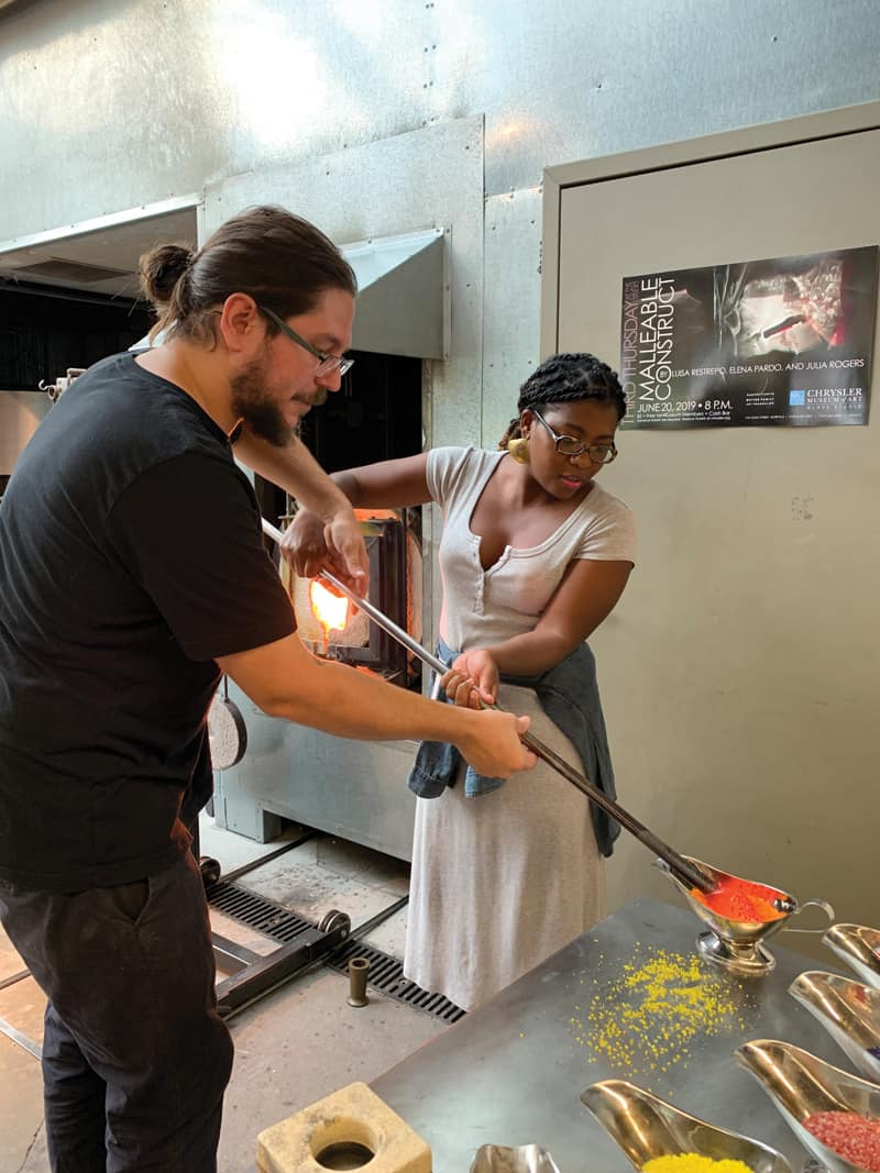 A pair of humans makes art glass at Chrysler