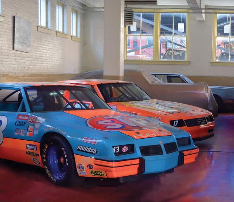Richard Petty's Pontiac race car and Darrell Waltrip's Chevrolet
