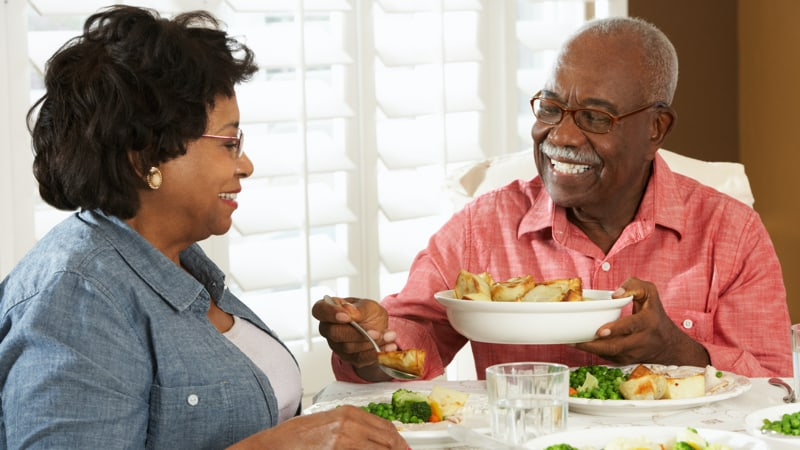 Married couple enjoying dinner at home together smiling Image