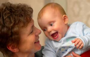 Baby with grandma who does baby talk too much Image