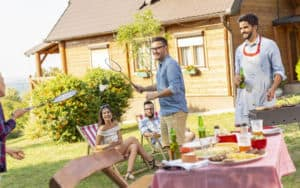 Neighbors throwing a backyard barbecue and not inviting their old neighbor Image