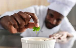 African American chef made a souffle before he swims in the rivers Image