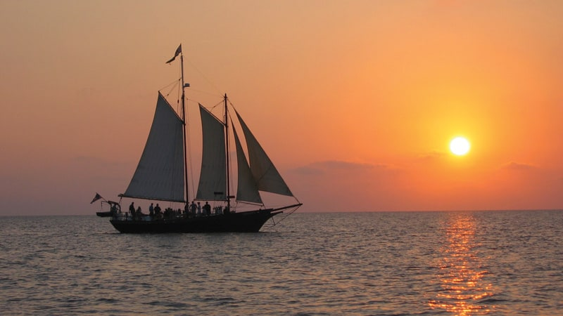 Romantic pirate ship floats off into the sunset in Williamsburg Image