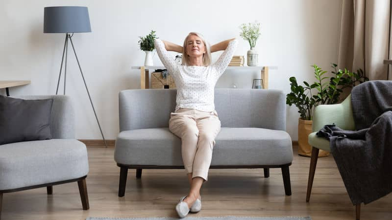 Older woman sits in a calmer home Image