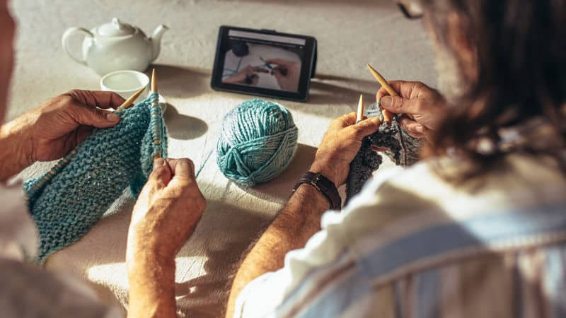 Two seniors learning knitting from home Image