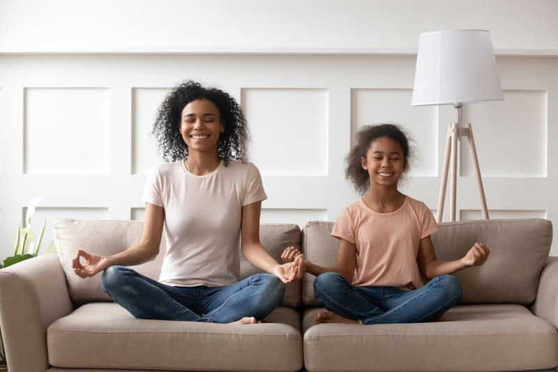 Mom and daughter can entertain by doing yoga
