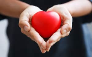 So, woman is holding her heart in her hands Image