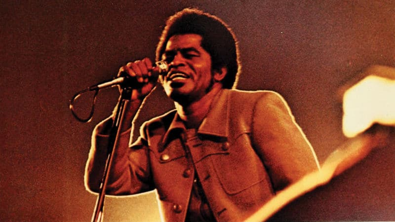 James Brown performing music in the '70s Image