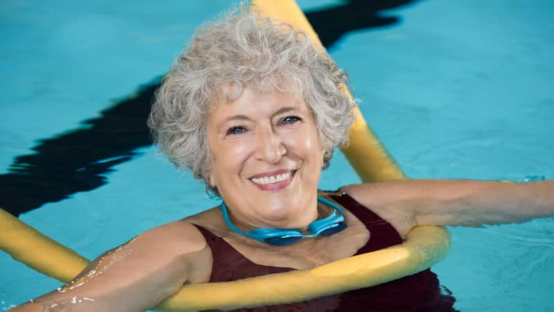Woman swimming in the pool to help her anxiety Image