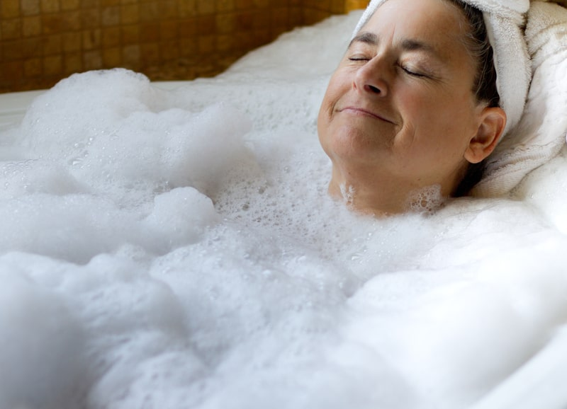 Senior woman in a bathtub relaxing
