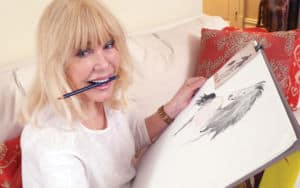 Loretta Swit showing off her art Image