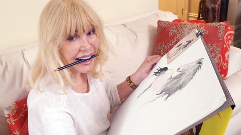 Loretta Swit showing off her art Image
