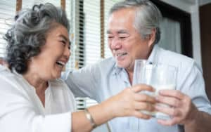 Senior couple drinks milk for their bones Image