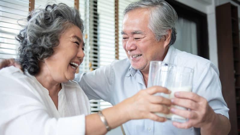 Senior couple drinks milk for their bones Image
