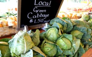 Farmers market week selling cabbage yum Image