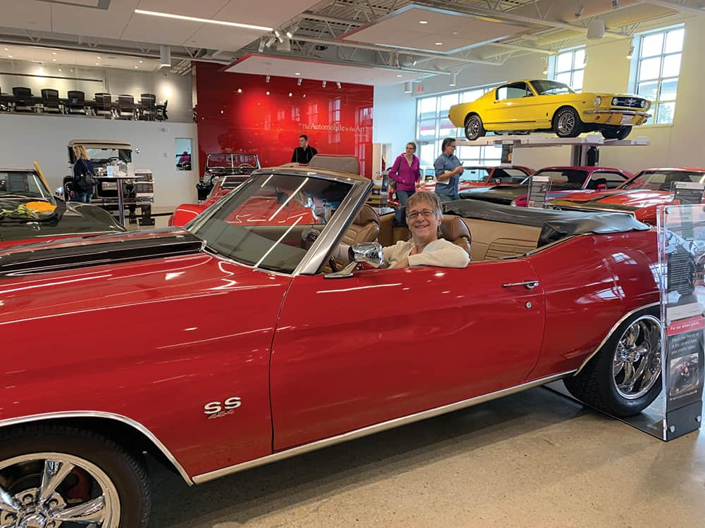 Annie Tobey in a 1972 Chevrolet Chevelle Custom at the Automobile Gallery