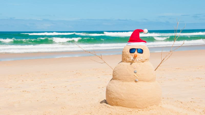 Snowman celebrates Christmas in July by listening to Baroque Image