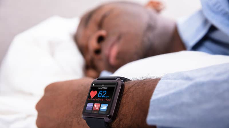 Man sleeps with sleep trackers Image
