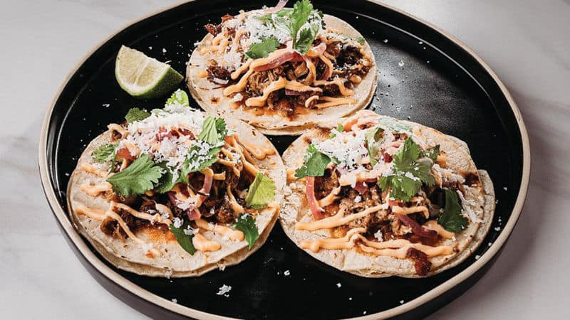 Charred tacos that might have barbecue in them Image