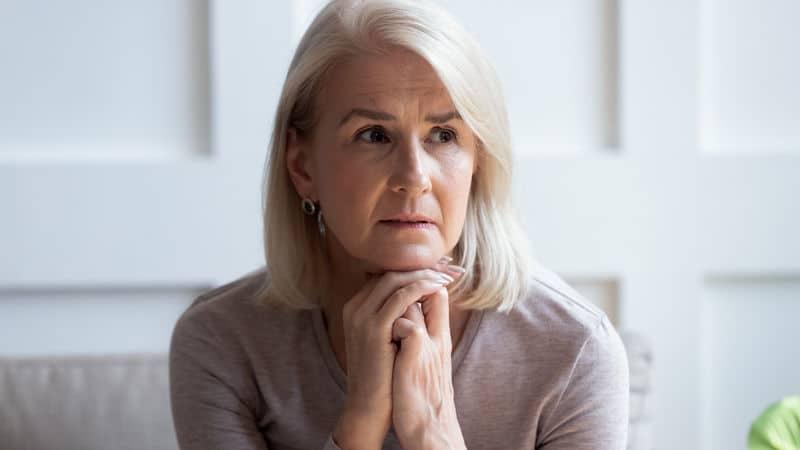 Senior woman knows family secret Image
