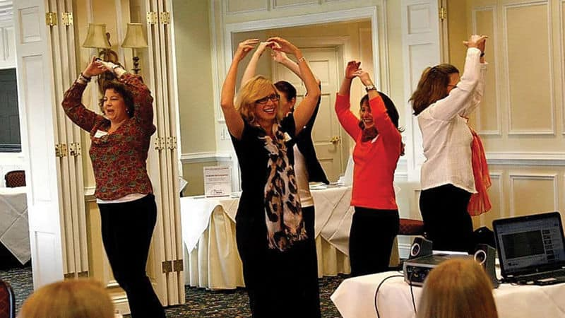 Christine Walters doing some sort of improv exercise Image