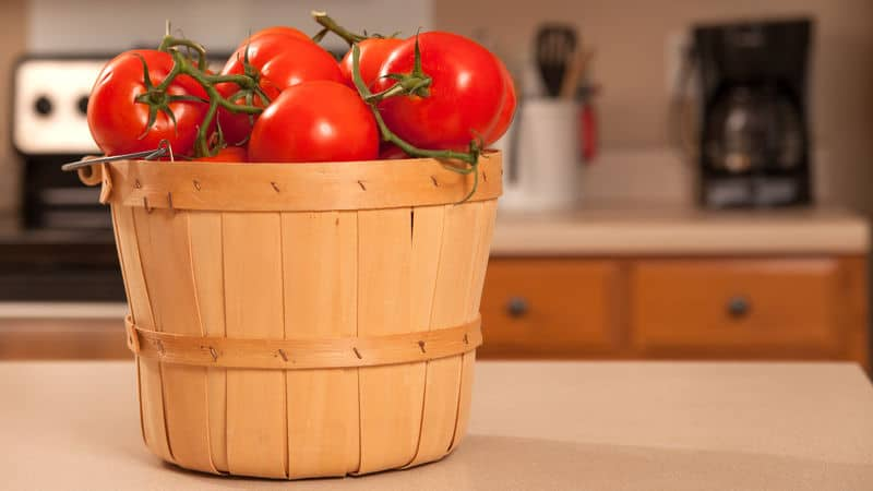 Really healthy tomatoes in a basket Image