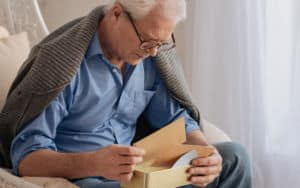 Senior man cannot get over these love letters like wow how sad Image