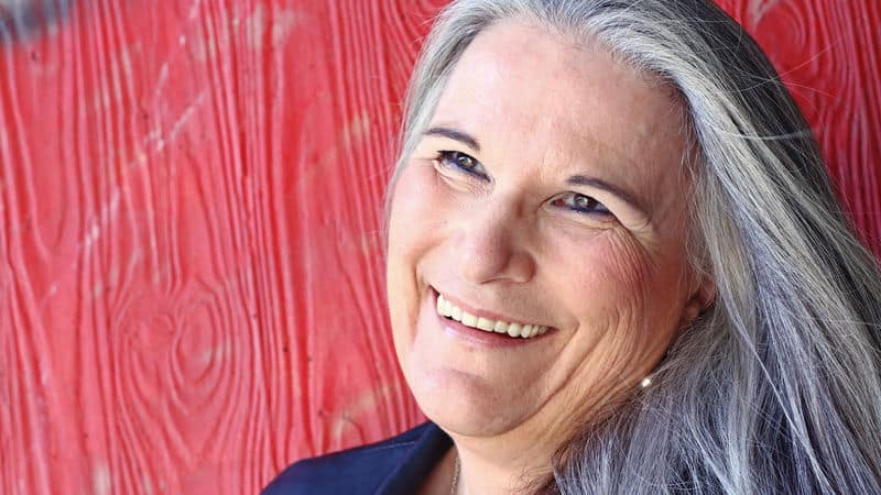 Gray haired woman is a beautiful silver fox Image