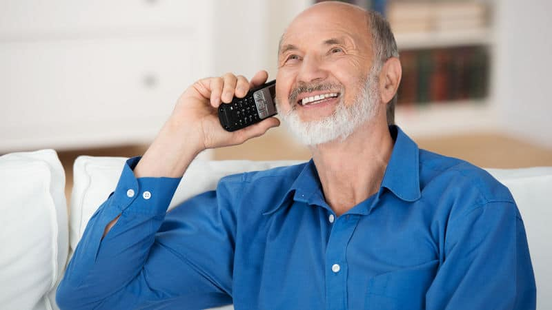 Senior man talking on the phone in Welsh Image